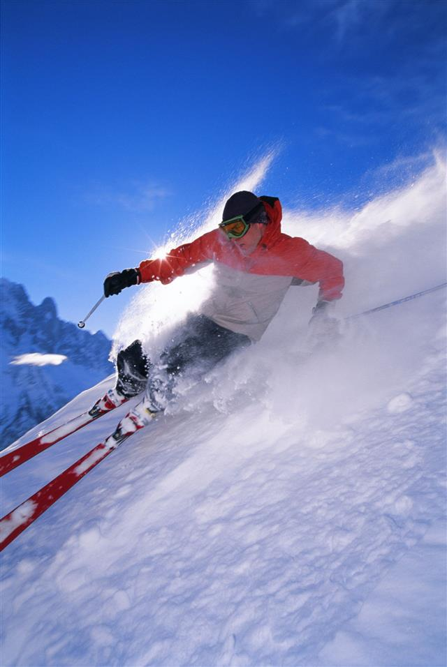 Man Skiing Down Steep Slope